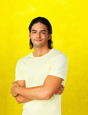 Buy stock photo Attractive casual man  with arms folded against yellow background