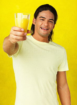 Buy stock photo Smiling man holding glass up in toast against yellow background