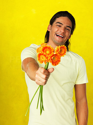 Buy stock photo Handsome man holding out bouquet of flowers