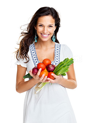 Buy stock photo Portrait of a smiling young woman holding a bright collection of colourful vegetables, isolated on white background