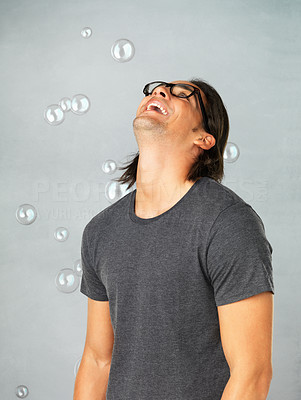 Buy stock photo Portrait of joyful man in glasses looking up and laughing