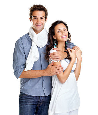 Buy stock photo Portrait of romantic young couple standing together on white background