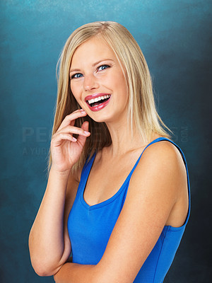Buy stock photo Portrait of happy blond woman smiling on blue background