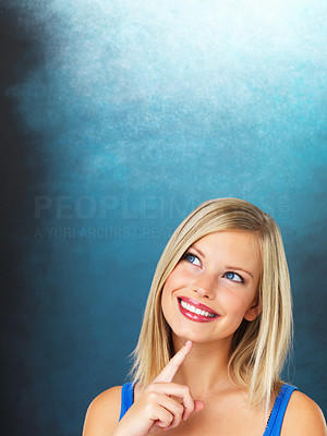 Buy stock photo Closeup of thoughtful woman looking up at copyspace