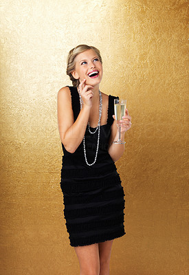Buy stock photo Pretty woman holding champagne glass and looking up