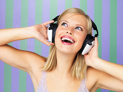 Buy stock photo Closeup portrait of pretty woman wearing headphones and looking up