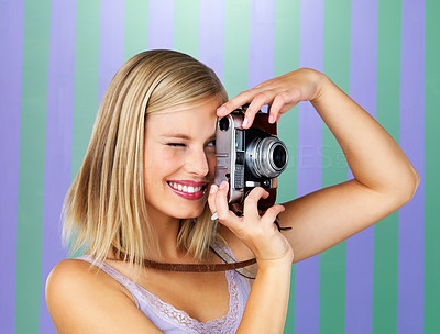 Buy stock photo Beautiful woman taking photo with vintage camera