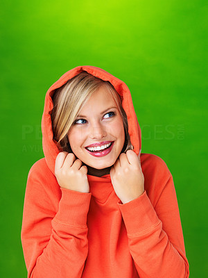 Buy stock photo Hoodie girl smiling on green background