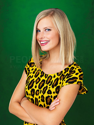 Buy stock photo Portrait of pretty woman standing with arms folded on green background