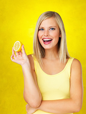 Buy stock photo Portrait of woman standing and holding lemon