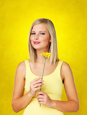 Buy stock photo Woman standing and holding flower