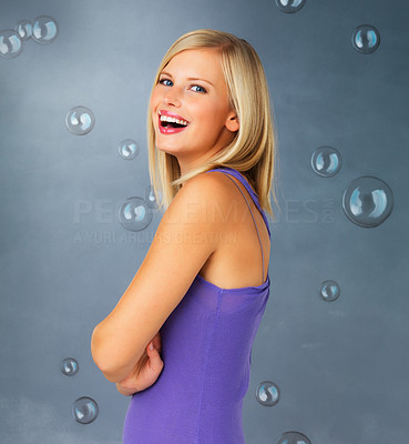 Buy stock photo Side view of pretty blonde woman smiling with arms crossed