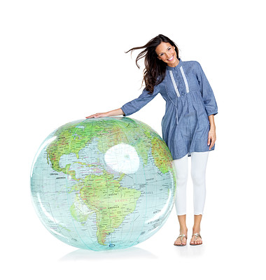Buy stock photo Portrait of a beautiful young girl standing by a globe against white background