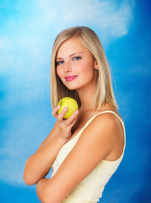 Buy stock photo Side view of woman standing and holding apple