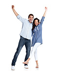 Young couple celebrating success with hands raised
