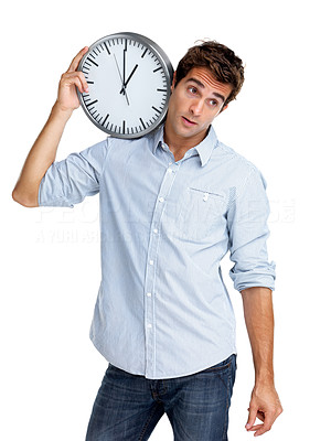 Buy stock photo Portrait of a thoughtful young man looking away while holding a clock on shoulder against white background