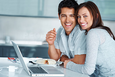 Buy stock photo Portrait of a happy young couple sitting together with laptop - Indoor