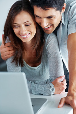 Buy stock photo Portrait of a romantic young couple surfing internet on laptop