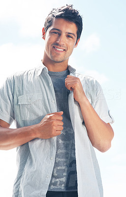 Buy stock photo Portrait of a handsome young man standing against bright background