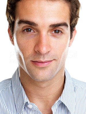 Buy stock photo Closeup portrait of a relaxed young man looking confidently against white background