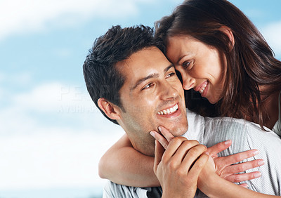 Buy stock photo Portrait of a cute young woman hugging her boyfriend from behind and smiling - Outdoor