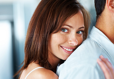 Buy stock photo Closeup portrait of a happy young female smiling at you while hugging her boyfriend