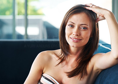 Buy stock photo Portrait of a lovely young female sitting on couch at home - Indoor