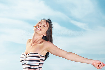Buy stock photo Portrait of an excited young lady celebrating her success against the sky - Outdoor