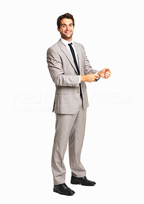 Buy stock photo Full length of business man buttoning his cuff on white background