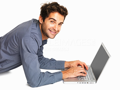 Buy stock photo Junior executive using a laptop while lying on white background