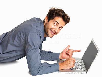 Buy stock photo Executive lying down while pointing towards laptop screen on white background