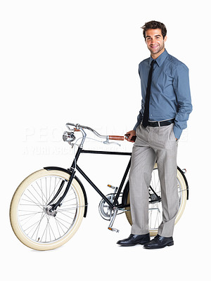 Buy stock photo Executive standing next to retro bicycle
