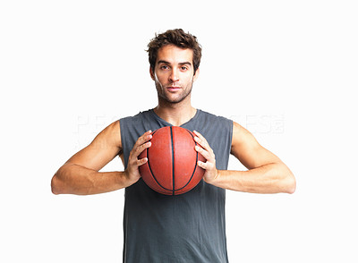 Buy stock photo Confident man holding basketball to his chest