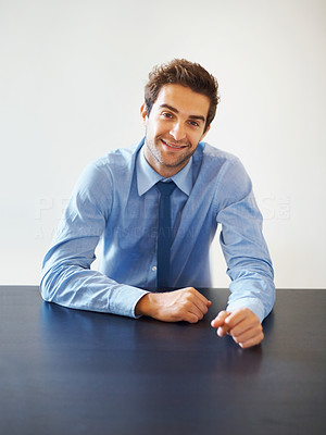 Buy stock photo Portrait of smiling young executive sitting in the office