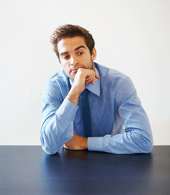 Buy stock photo Portrait of young business man with hand on chin looking away