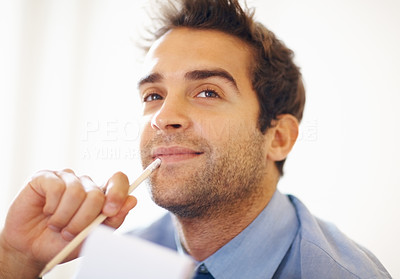 Buy stock photo Closeup portrait of thoughtful young business man with pencil and notepad