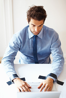 Buy stock photo Young business man sitting with the laptop hands taped