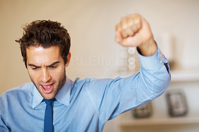 Buy stock photo Executive raising fist in excitement, in front of laptop