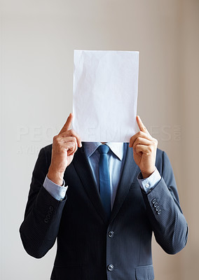 Buy stock photo Executive holding up card to cover his face