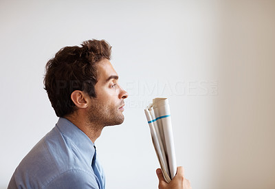 Buy stock photo Side view of executive looking frustrated while gripping papers