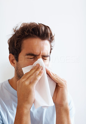 Buy stock photo View of man blowing his nose