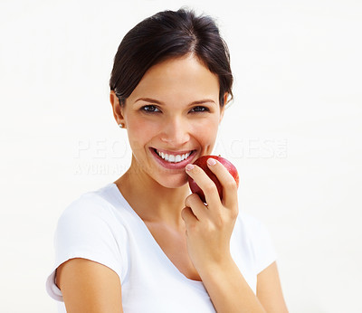 Buy stock photo Portrait of beautiful young woman eating an apple isolated over white background