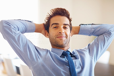 Buy stock photo Businessman smiling while he relaxes with hands behind head