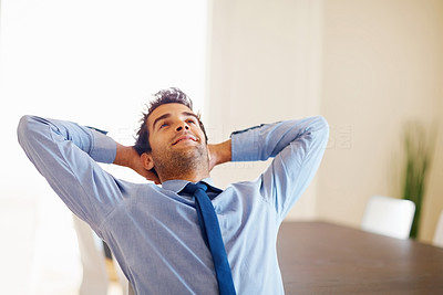 Buy stock photo Businessman looking up and relaxing with hands behind head