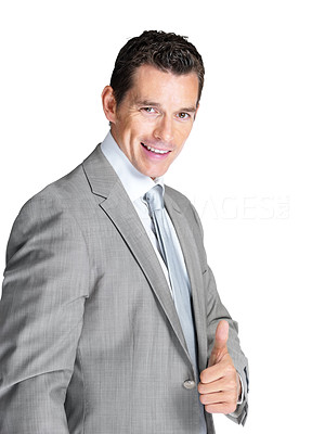 Buy stock photo Portrait of a handsome young male business executive showing thumbs up sign against white background