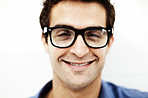 Cheerful young guy in glasses isolated against white