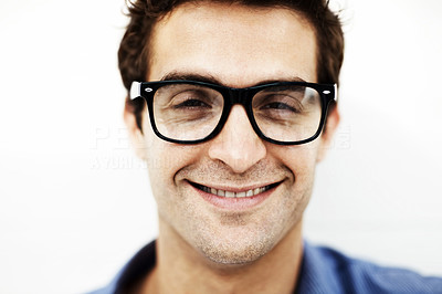 Buy stock photo Closeup portrait of a cheerful young guy in glasses against white background