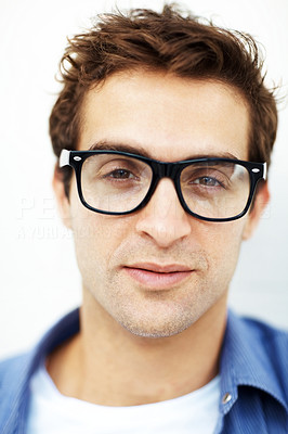 Buy stock photo Closeup portrait of casual young man wearing glasses against white background