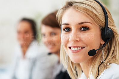 Buy stock photo Closeup of female support operator smiling with staff in background