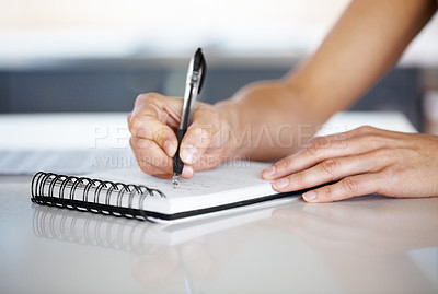 Buy stock photo Closeup of a female hand writing notes on notepad at desk